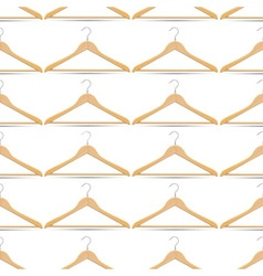 Seamless pattern with wooden hangers vector image