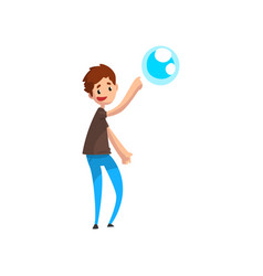 Teen boy pointing his finger at soap bubble vector