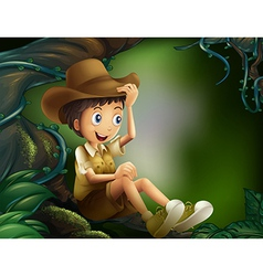 A boy sitting in a tree at the rainforest vector image