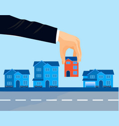 Row of modern houses near road and human hand vector