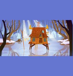 wood stilt house at frozen swamp in winter forest vector image