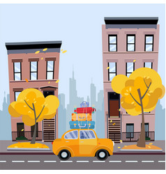 yellow car with suitcases on roagainst vector image
