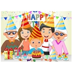 Happy boy blowing birthday candles with his family vector