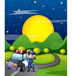A policeman with a police car at the road vector image vector image