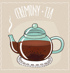 Glass teapot with black tea vector