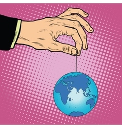 Planet earth in hand on the rope vector image