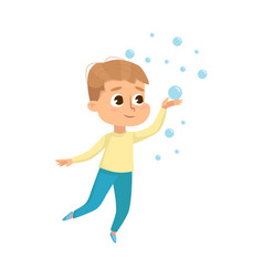 Cute little boy playing with soap bubbles kids vector