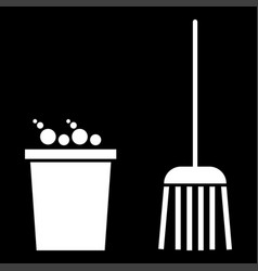 Bucket and broom it is the white color icon vector