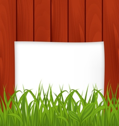 Paper sheet and green grass on wooden texture vector image vector image