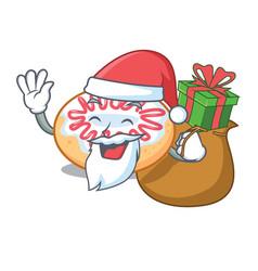 Santa with gift jelly donut mascot cartoon vector