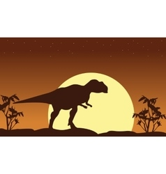 Silhouette of mapusaurus scenery at sunrise vector