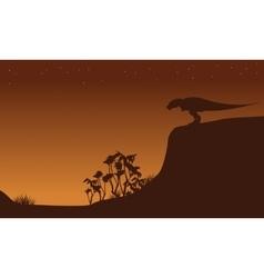 Silhouette of Tyrannosaurus on cliff vector image
