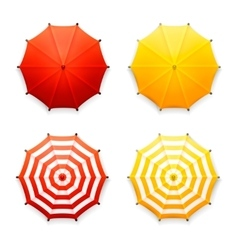 Isolated red and yellow beach umbrellas top view vector