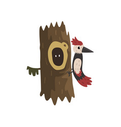 Woodpecker on a hollow tree hollowed out old tree vector