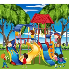 Kids play on slide at the playground vector