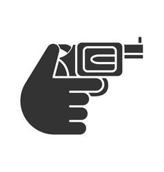 hand holding revolver glyph icon vector image