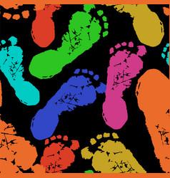 Human footprints on black background vector