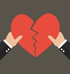 Hands tearing apart heart symbol vector