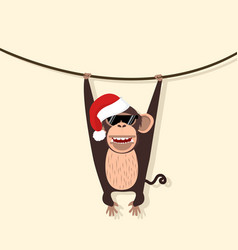 monkey wear hat christmas climbing the vine vector image