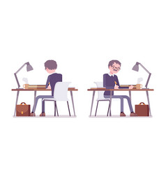 male teacher sitting and working at the desk vector image