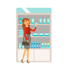 Woman in red top in pharmacy choosing and buying vector