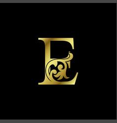 Gold luxury letter e ornament logo alphabet vector