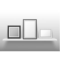 empty photo frames standing on white shelf vector image