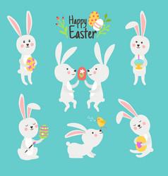 Happy easter bunnies with eggs vector