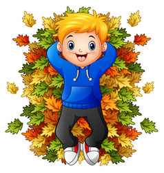 happy little boy playing with autumn leaves vector image