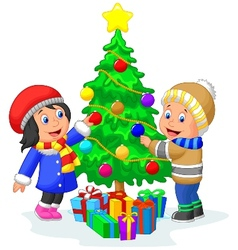 Happy kids cartoon decorating a Christmas tree wit vector