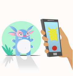 Photographing a cute monster on a smartphone vector