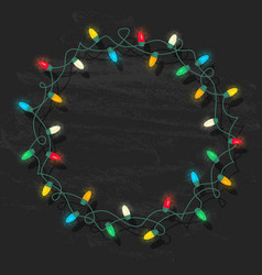 Circle frame of glowing colorful christmas lights vector