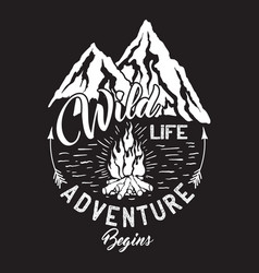 wildlife inscription with mountains and campfire vector image vector image