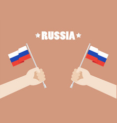 Hands holding up russia flags vector