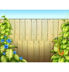An iguana inside fence vector