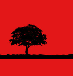 tree at hill silhouette on red vector image