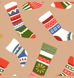 Knitted warm socks with different ornaments vector