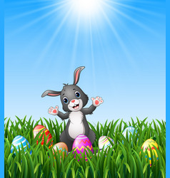 easter bunny cartoon with easter eggs in the grass vector image