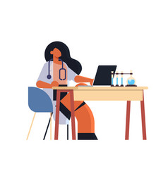 Female practitioner doctor using laptop woman vector