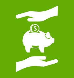 piggy bank and hands icon green vector image vector image