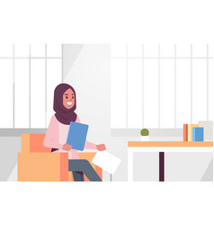 Arabic businesswoman sitting at workplace desk vector