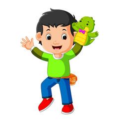 Happy boy was using crocodile puppet vector