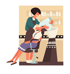 Hairdresser washing hair to girl client in beauty vector