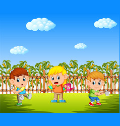 happy kids planting in the cornfield vector image