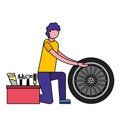 mechanic man with tyre car and tools vector image
