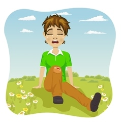 Crying boy with wounded leg in park vector