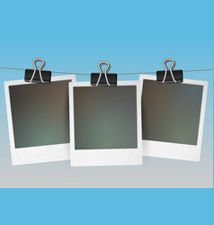 three blank picture frames hanging vector image