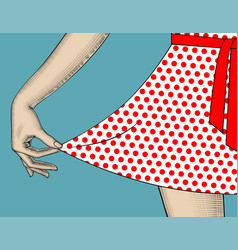 Womans hand pull the edge of the polka-dot dres vector