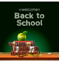 Back to school school books with apple on desk vector