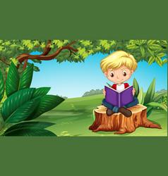 Cute boy reading book in park vector